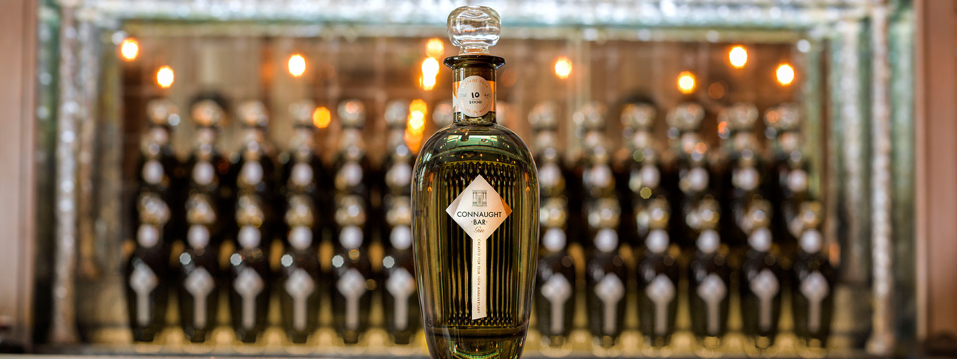 Bottle of gin on marble counter at The Connaught Bar in Mayfair