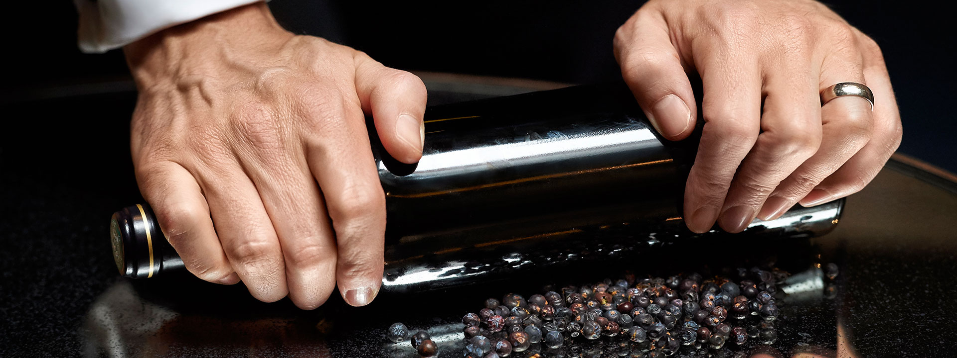 Rolling berries with a bottle of The Connaught bar gin