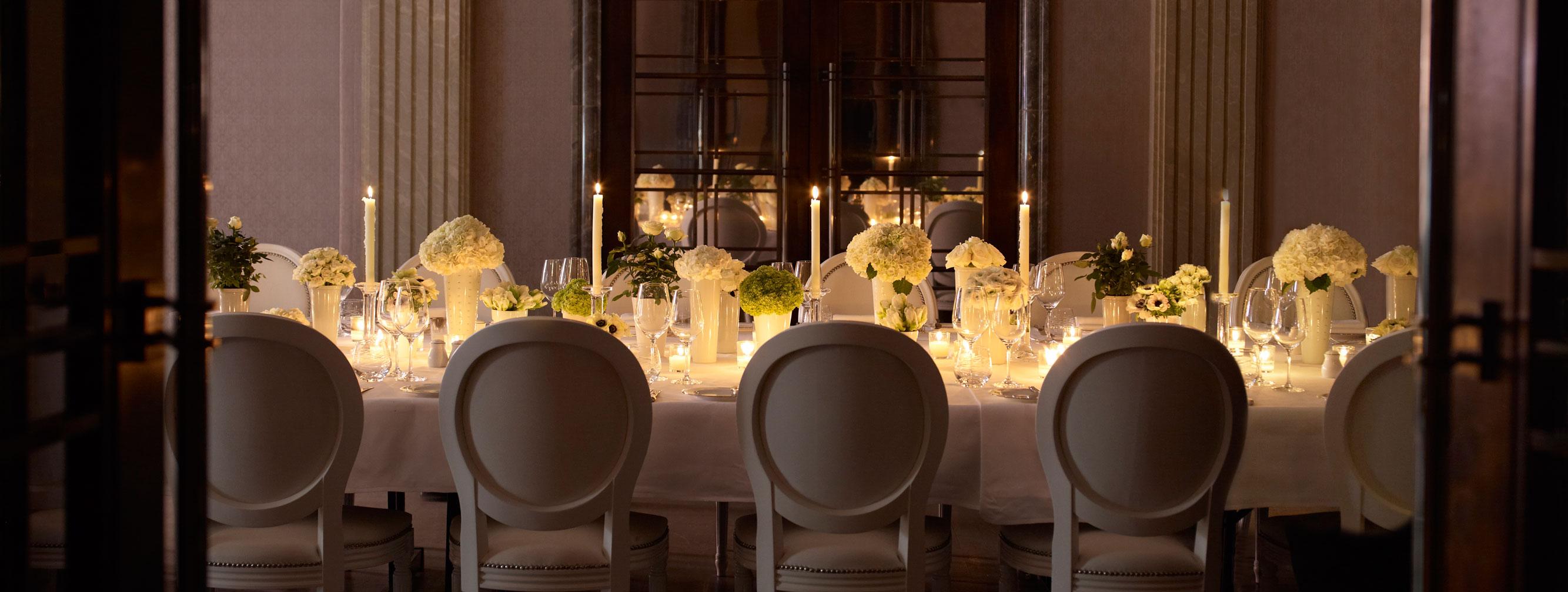An all white set dinner table