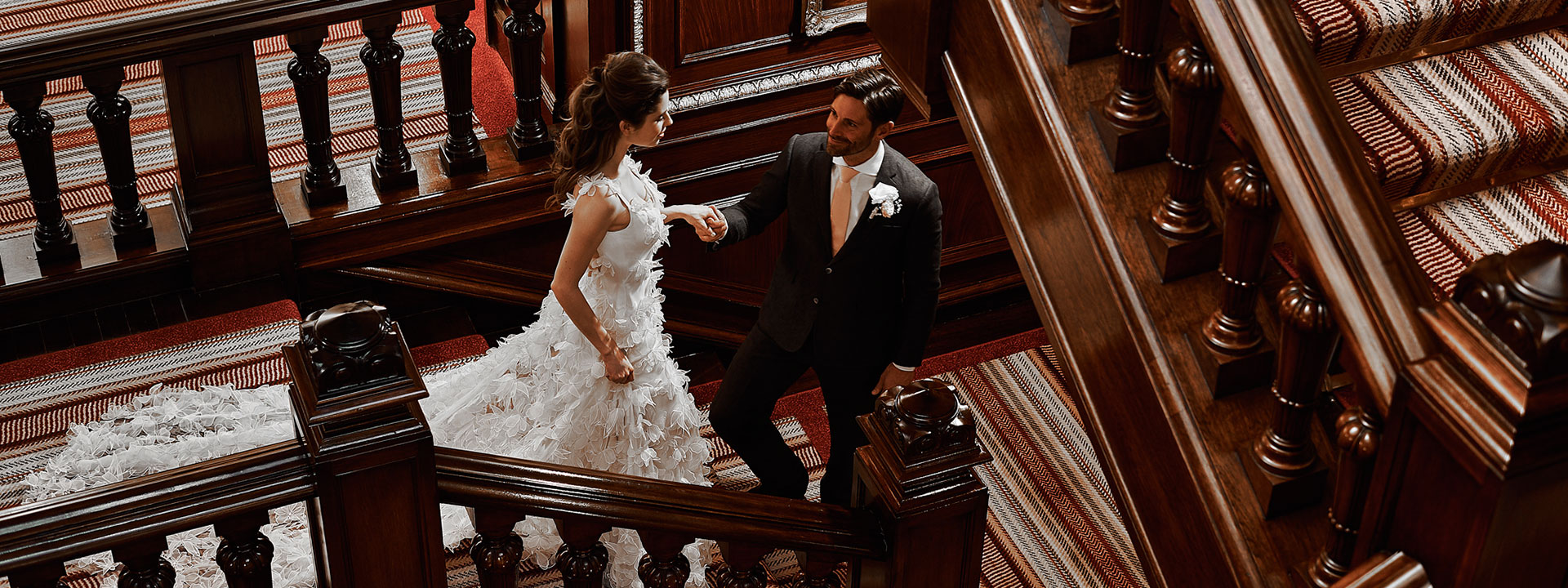 Bride and groom on the stairwell at The Connaught
